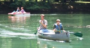 Teens canoeing during the five-week summer program