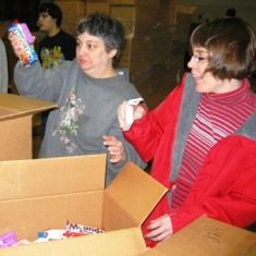 participants in Employment Transition Program packing boxes