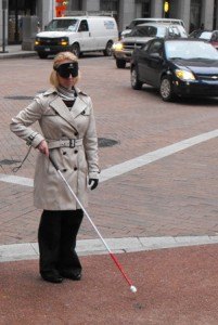 BVRS President Erika Arbogast navigates Downtown Pittsburgh streets under blindfold using a white cane