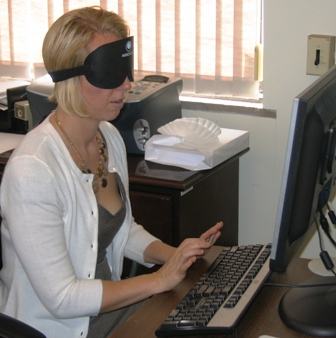BVRS President Erika Arbogast, under blindford, learns screen reading software at her computer