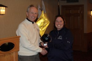 Lisa Wilig, fastest female skier receiving award from George Ehringer