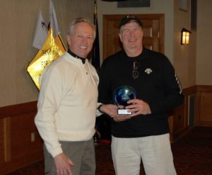 Tim Chappell, fastest male skier receiving award from George Ehringer