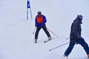 Blind skier Bubba and his Guide nearing the finish line