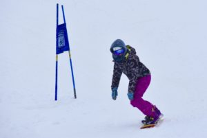 snowboarder finishing race